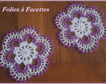 White and purple flowers with 2 crocheted doilies
