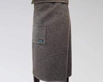 Size M/L, NorSari® is a wool outerwear wrap. It's a simple, yet beautiful way to stay warm. Wrap on OVER your clothes. Warm blanket skirt.