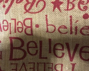 Burlap printed believe in red.