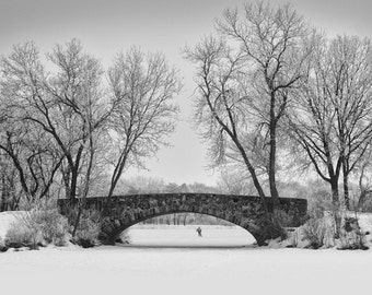 The Ice Tester black and white photograph, ice skating, snow, frozen pond, old stone bridge