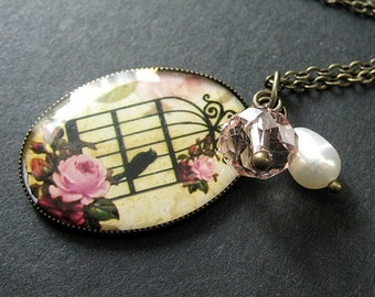 Birdcage Necklace in Pink and Bronze with Crystal Charm and Fresh Water Pearl. Handmade Jewelry.