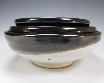 Trio of handmade, stoneware, nesting bowls. Three white and black bowls