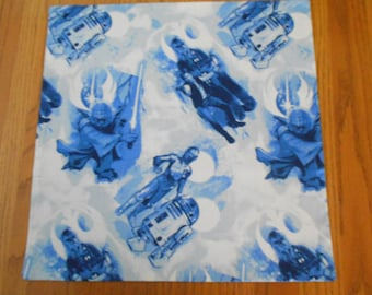 "PC-65  18""X18""  Star Wars pillow cover featuring Han Solo, Chewbacca, Yoda, R2D2 and C3PO all in blue on a white background."
