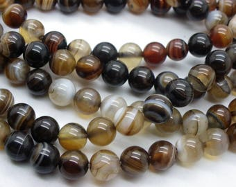 45-46 agate 8 mm Brown and beige agate. faceted sold yarn