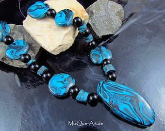 Pearl necklace with irregular blue-black beads