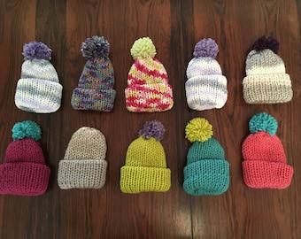 Newborn knitted pom hat