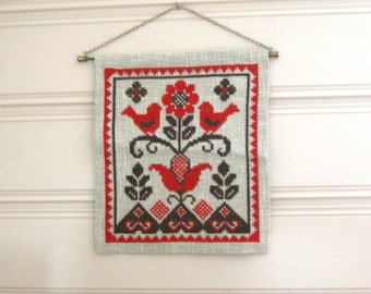 Embroidered wall hanging with birds