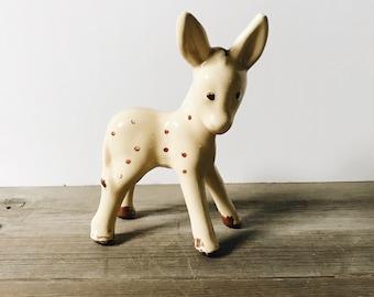 Vintage pale yellow ceramic deer with brown spots