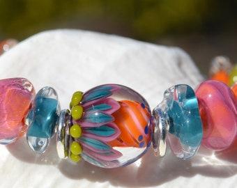 EYE CANDY- Handmade Lamp Work and Sterling Silver Bracelet