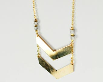 Double collar arrow howlite and gold metal