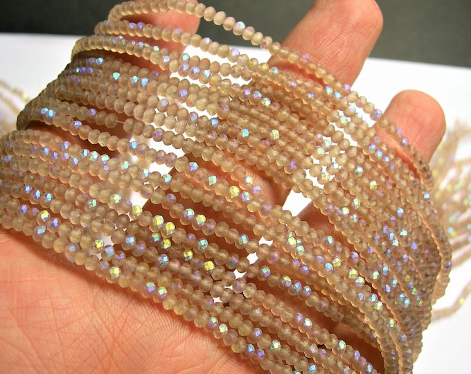 Crystal - rondelle faceted 3mm x  2mm beads - 195 beads - AA quality - Mystic beige ab frosted - CAA2G164