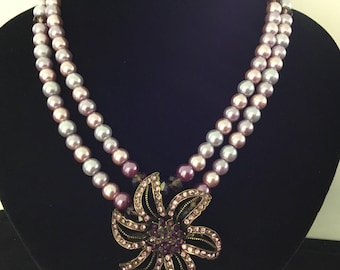 2 rows necklace of multiple shades of pearls and crystals with flower brooch pendant.