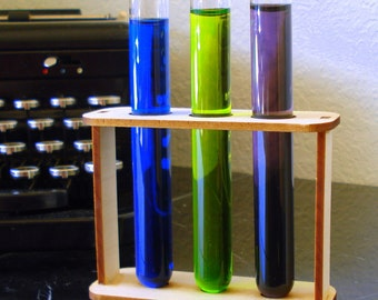 Three custom test tubes and holder