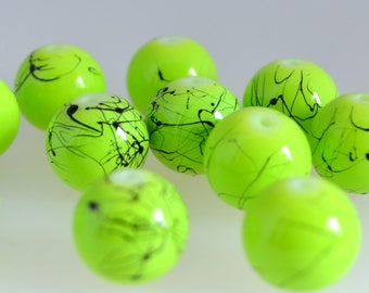 10 green round beads, Black opaque glass