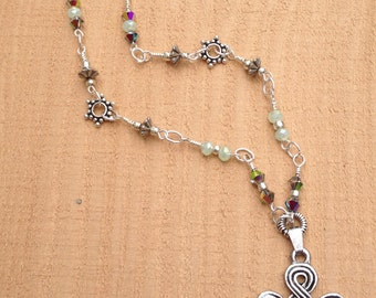Hand linked bead necklace with celtic pendant