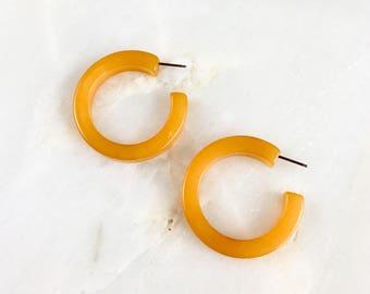 Vintage Orange Bakelite Hoops