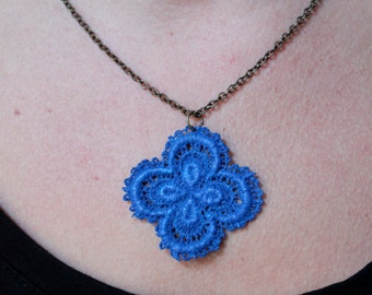 Necklace with blue lace pendant.