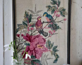 A beautiful framed vintage exotic bird and Hibiscus wool needlepoint
