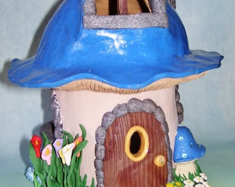 Mushroom fairy house with garden