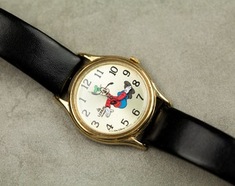 Vintage Rare Goofy midsize watch Disney Goofy Dial watch runs backwards gold tone case and black leather strap