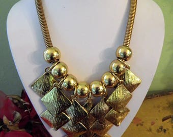 Chunky, Bold Disc and Bead Bib Necklace.