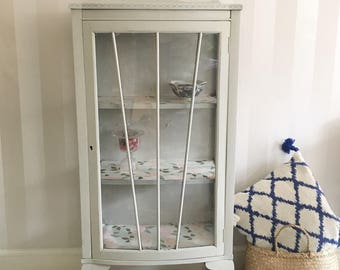 Grey painted antique china cabinet with claw feet
