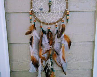 Dream Catcher in natural Hemp and angora feathers.