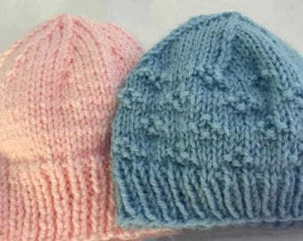Hand knit blue or pink newborn hats