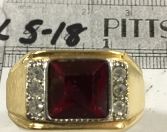 Used - Seta gold tone ring size 10.5 with red stone