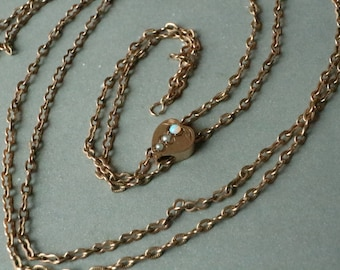 Antique 10K solid gold ladies watch chain with, the slider decorated with an opal and seed pearl.