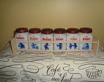 Mid Century Kitschy Vintage 7 piece Glass Dutch Spices Condiments with Wood Rack