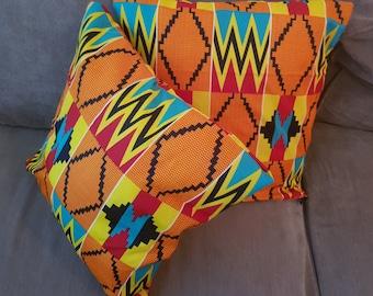 Bright orange kente print cushion cover