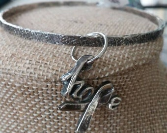 fine silver statement of hope dangles from silver bangle