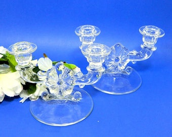 A Pair of Pressed Glass Double Candle Holders Flower Centers