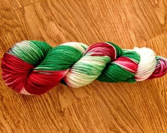 Green, red, and white superwash merino wool nylon 75/25 blend 100 gram 245 yards DK weight