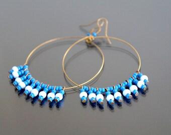 Hoop earrings blue beads.