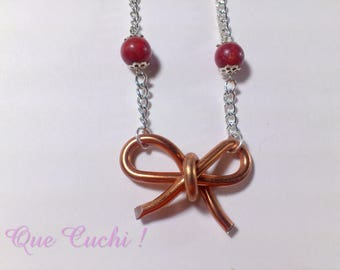 Aluminum bow tie necklace with coral beads