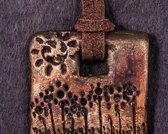 Bronzed sunny garden clay pendant