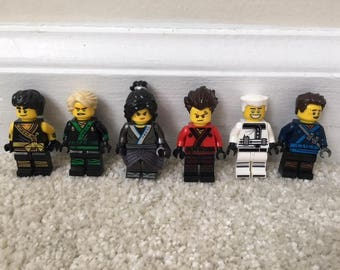 NINJAGO Set of 6 Minifigures w Training Gear. Perfect for Cake Toppers or Party Favors. Includes Lloyd Cole Jay Titanium Zane and more.