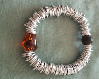 decorated with an amber bead aluminum rings