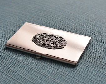silver tone business card case with filigree stamping