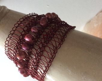 A Flat Wide hand knitted bracelet
