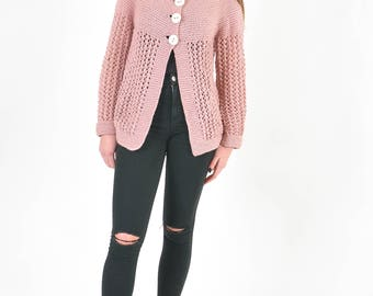 Handknit cardigan in pink