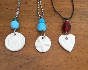 Essential Oil Diffuser necklace made with kiln fired clay and glass beads