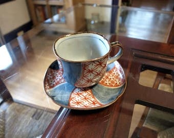 Hand Painted Stoneware Asian Tea Cup and Saucer– Blue, Red and Gray Glaze and Signed