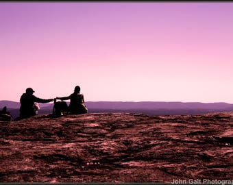 Couple Touching Hands on Mountain Top
