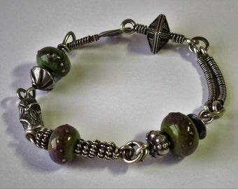 Sterling Silver Bracelet with lampwork beads, Bali beads, & a Bob Burkett dragonfly bead