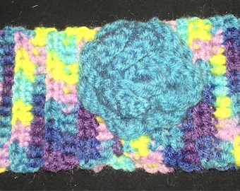 Multi colored ear warmer with blue rose