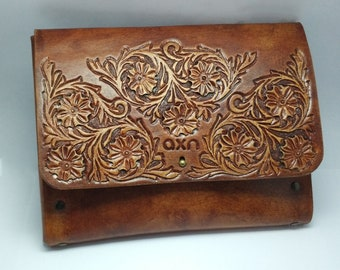 Hand tooled leather clutch bag