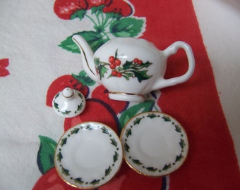 tiny teapot with tiny saucers